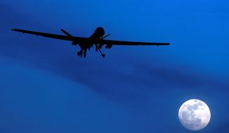 """FILE - In this Jan. 31, 2010 file photo, an unmanned U.S. Predator drone flies over Kandahar Air Field, southern Afghanistan on a moonlit night. Today, when U.S. intelligence agencies believe they know the location of a terrorist in Pakistan and a few other countries, they are largely free to deploy a weapon that's become the symbol of war on terror: an aerial drone. The drone drops a bomb or fires a missile that executes the suspect. University of Utah law professor Amos Guiora is pushing for another step before the U.S. government or military could decide to kill a terror suspect with a drone. In a proposal to be published in 2015, Guiora and a colleague are pushing for what they call a """"drone court."""" The court would be part of the judiciary branch and hear arguments for why the United States should target a suspect with a drone strike. (AP Photo/Kirsty Wigglesworth, File)"""