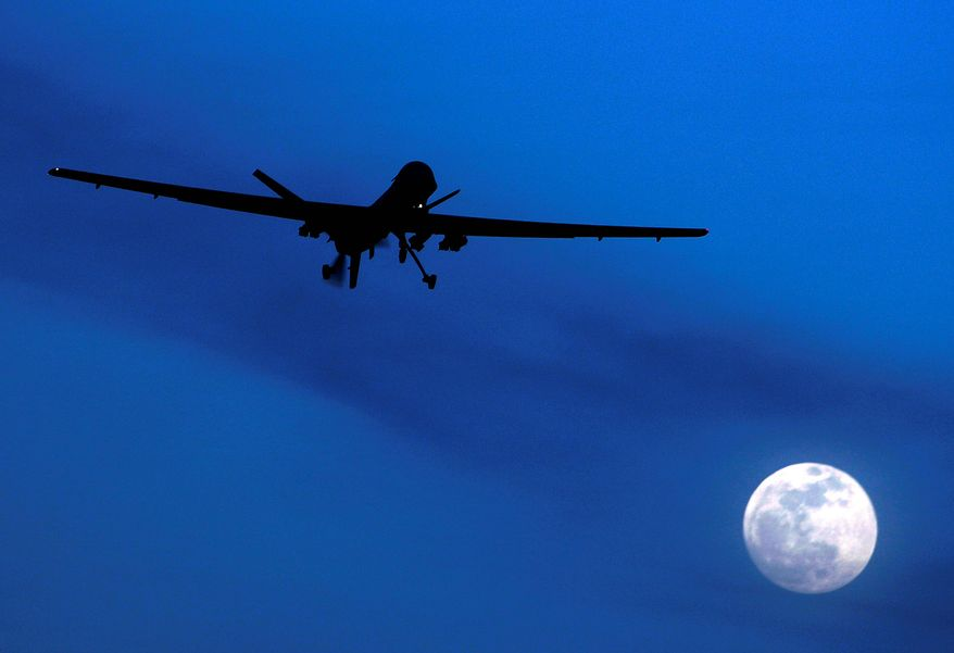 "FILE - In this Jan. 31, 2010 file photo, an unmanned U.S. Predator drone flies over Kandahar Air Field, southern Afghanistan on a moonlit night. Today, when U.S. intelligence agencies believe they know the location of a terrorist in Pakistan and a few other countries, they are largely free to deploy a weapon that's become the symbol of war on terror: an aerial drone. The drone drops a bomb or fires a missile that executes the suspect. University of Utah law professor Amos Guiora is pushing for another step before the U.S. government or military could decide to kill a terror suspect with a drone. In a proposal to be published in 2015, Guiora and a colleague are pushing for what they call a ""drone court."" The court would be part of the judiciary branch and hear arguments for why the United States should target a suspect with a drone strike. (AP Photo/Kirsty Wigglesworth, File)"