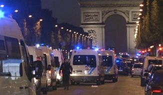 In this image made from video, police attend the scene after an incident on the Champs-Elysees in Paris, Thursday April 20, 2017. French media are reporting that two police officers were shot Thursday on the famed shopping boulevard. (AP Photo)