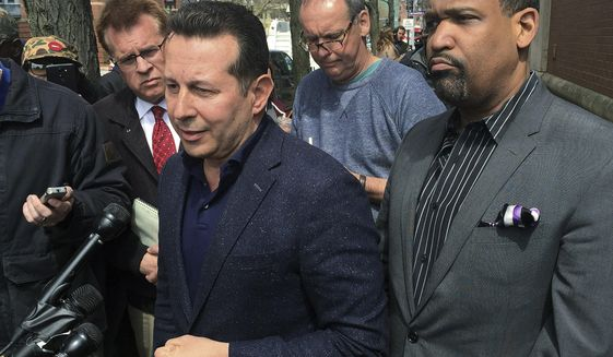 "Attorneys Jose Baez, left, and Ronald Sullivan, who successfully defended former New England Patriots player Aaron Hernandez in a double-murder case, hold a briefing outside the state medical examiner's office, Thursday, April 20, 2017, in Boston. Baez accused Massachusetts' chief medical examiner of ""illegally"" holding the brain of the ex-NFL star, who was found Wednesday hanged in his prison cell. Baez said Hernandez's family had arranged for Boston University to study the former tight end's brain as part of its concussion research. (AP Photo/Collin Binkley)"