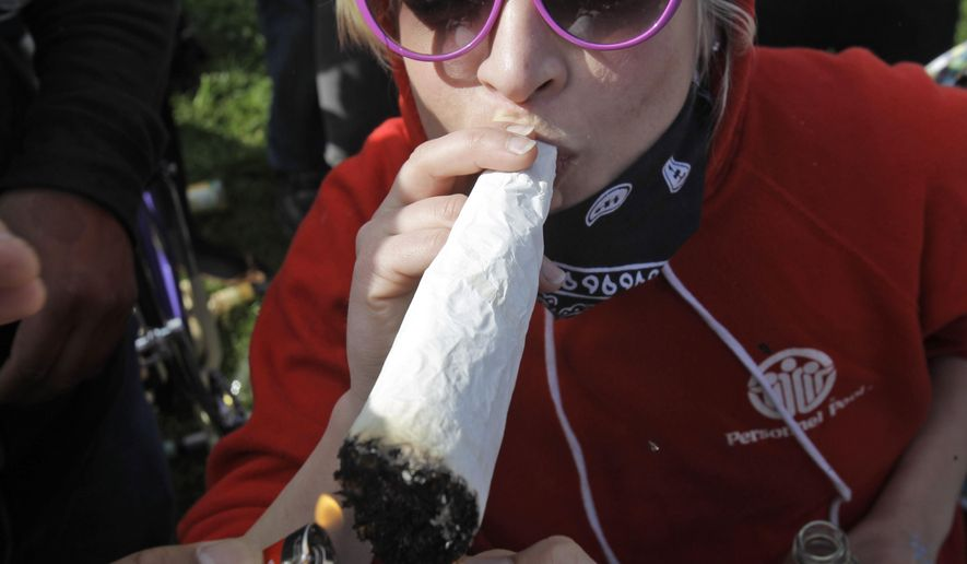 In this April 20, 2010, file photo, a large marijuana joint is lit at Golden Gate Park in San Francisco.  (AP Photo/Marcio Jose Sanchez, File)