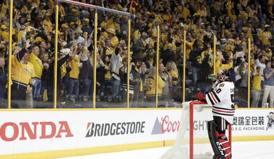 Chicago Blackhawks goalie Corey Crawford (50) takes a drink as Nashville Predators fans cheer after Predators defenseman Roman Josi scored during the second period in Game 4 of a first-round NHL hockey playoff series Thursday, April 20, 2017, in Nashville, Tenn. (AP Photo/Mark Humphrey)