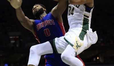 FILE - In this March 31, 2017, file photo, Milwaukee Bucks forward Giannis Antetokounmpo, right, is defended by Detroit Pistons center Andre Drummond during the second half of an NBA basketball game, in Milwaukee. Steel beams and giant cranes tower over a busy construction site next to the Bradley Center that will turn into the next home of the Milwaukee Bucks. The building of a new arena isn't the only sign of progress around the franchise. From the emergence of Giannis Antetokounmpo as an NBA All-Star to a return to the playoffs, this has been an important season for Milwaukee. (AP Photo/Darren Hauck, File)