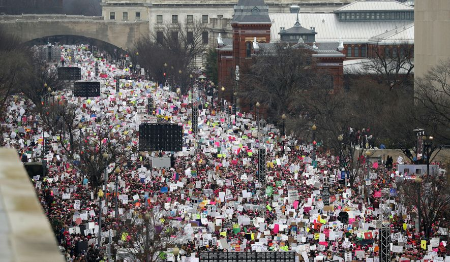 In this Jan. 21, 2017, file photo, a crowd fills Independence Avenue during the Women's March on Washington, in Washington. The major protests in Washington that have greeted President Donald Trump's first year in office are set to return in force, continuing an already expensive year for city officials who work to keep people safe during mass gatherings. (AP Photo/Alex Brandon, File)