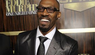 "FILE- In this Nov. 3, 2012 file photo, comedian Charlie Murphy appears at ""Eddie Murphy: One Night Only,"" a celebration of Murphy's career in Beverly Hills, Calif. Comedian Cedric the Entertainer said on Instagram that Murphy was laid to rest April 19, 2017, a week after his death following a battle with leukemia. (Photo by Chris Pizzello/Invision/AP, File)"