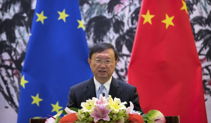 Chinese State Councilor Yang Jiechi speaks during a joint press conference with Federica Mogherini, High Representative of the European Union for Foreign Affairs and Security Policy, at the Diaoyutai State Guesthouse in Beijing, Wednesday, April 19, 2017. (AP Photo/Mark Schiefelbein)