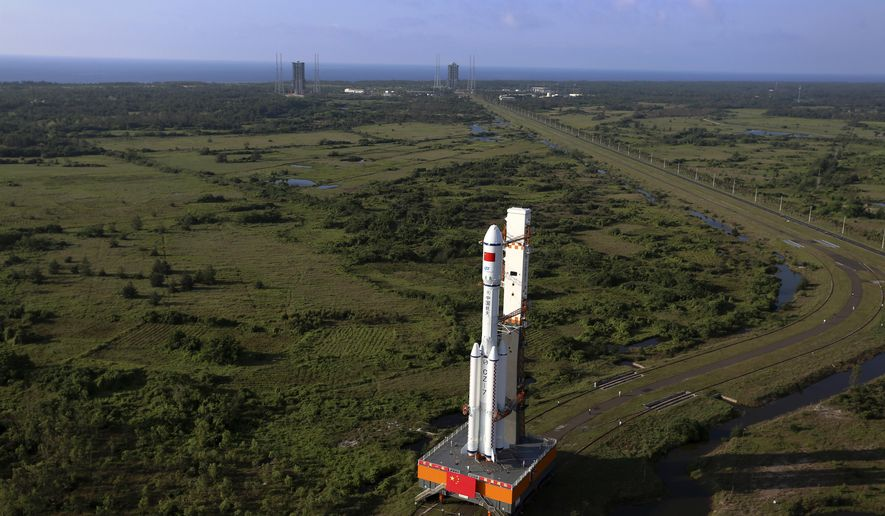 In this Monday, April 17, 2017 photo released by China's Xinhua News Agency, a Long March 7 rocket carrying the Tianzhou 1 is transferred to the launching site in Wenchang, south China's Hainan Province. China is preparing to launch its first unmanned cargo spacecraft on a mission to dock with the country's space station. The Tianzhou 1 was due to blast off at 7:41 p.m. (1141 GMT) Thursday atop a latest-generation Long March 7 rocket from China's newest spacecraft launch site. (Zeng Tao/Xinhua via AP)