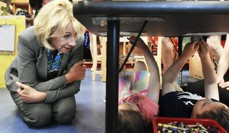 U.S. Education Secretary Betsy DeVos, left, talks with pre-k students Alivia, 5, and Kellen, 5, while visiting Laura Foster's class at the Van Wert Early Childhood Center, Thursday, April 20, 2017, in Van Wert, Ohio. American Federation of Teachers President Randi Weingarten joined DeVos during the visit. (Cathie Rowand/The Journal-Gazette via AP)