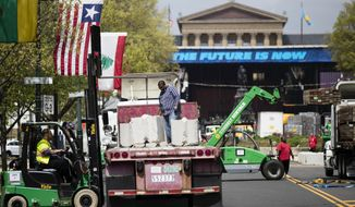 Workmen make preparations for the upcoming 2017 NFL football draft on the steps of the Philadelphia Museum of Art in Philadelphia, Thursday, April 20, 2017. When the NFL chose Philadelphia to host the 2017 draft, they insisted on holding the three-day event at the Art Museum in front of the iconic Rocky steps. Mayor Jim Kenney and city officials made it happen so construction crews are putting together a 3,000-seat theater for an extravaganza that's expected to draw about 200,000 people to the venue. (AP Photo/Matt Rourke)