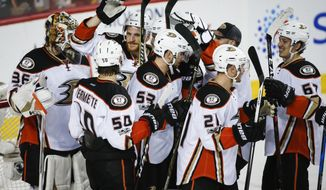 Anaheim Ducks players celebrate after defeating the Calgary Flames 3-1 in Game 4 in a first-round NHL hockey Stanley Cup playoff series Wednesday, April 19, 2017, in Calgary, Alberta. The Ducks swept the series. (Jeff McIntosh/The Canadian Press via AP)