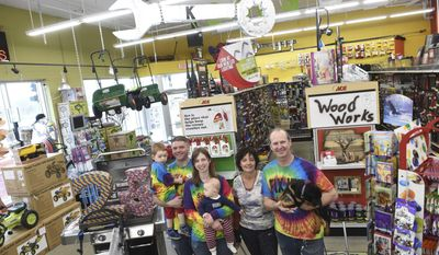 """ADVANCE FOR SATURDAY, APRIL 22, 2017 - In this April 13, 2017 photo, three generations of Crosby's pose for a photo in Kendall's Ace Hardware in St. Paul, Minn. From left, Matt and Ashley Lloyd hold their sons Axel, 2 1/2 and Kaden, 8-months-old, while standing next to Alexandra and Kendall Crosby. Ashley Lloyd is Kendall Crosby's daughter and Matt is her husband. Kendall's Ace Hardware now bills itself as """"The Friendliest Stores in Town."""" (Scott Takushi/Pioneer Press via AP)"""