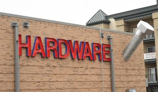 "ADVANCE FOR SATURDAY, APRIL 22, 2017 - In this April 13, 2017 photo, a giant screw appears to pierce the wall of Kendall's Ace Hardware in St. Paul, Minn. In addition to colorful, frequently-changing storefront displays, the giant screw jutting out near the roof line serves as the store's most visible prop. Kendall's Ace Hardware bills itself as ""The Friendliest Stores in Town."" (Scott Takushi/Pioneer Press via AP)"