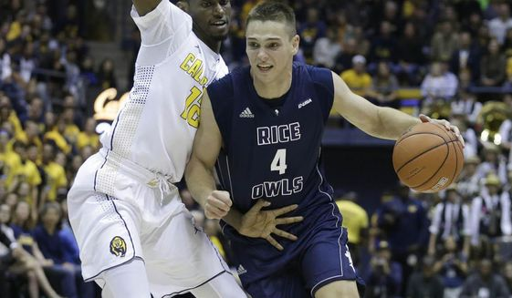 FILE - In this Nov. 13, 2016, file photo, Rice's Egor Koulechov, right, drives the ball past California's Roger Moute a Bidias during the first half of an NCAA college basketball game, in Berkeley, Calif. Florida is getting a graduate transfer to help replace versatile forward Devin Robinson.Rice swingman Egor Koulechov announced Tuesday night, April 18, 2017,  on Twitter that he plans to transfer to Florida, where he will be eligible to play right away. The Gators are awaiting NCAA paperwork before making an official announcement. (AP Photo/Ben Margot, File)