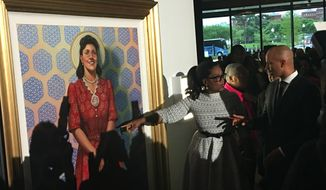 Oprah Winfrey gestures to a portrait of Henrietta Lacks at a screening of her film, The Immortal Life of Henrietta Lacks, at the African American History Museum in Washington D.C. on Wednesday. (Photograph by Laura Kelly/The Washington Times)
