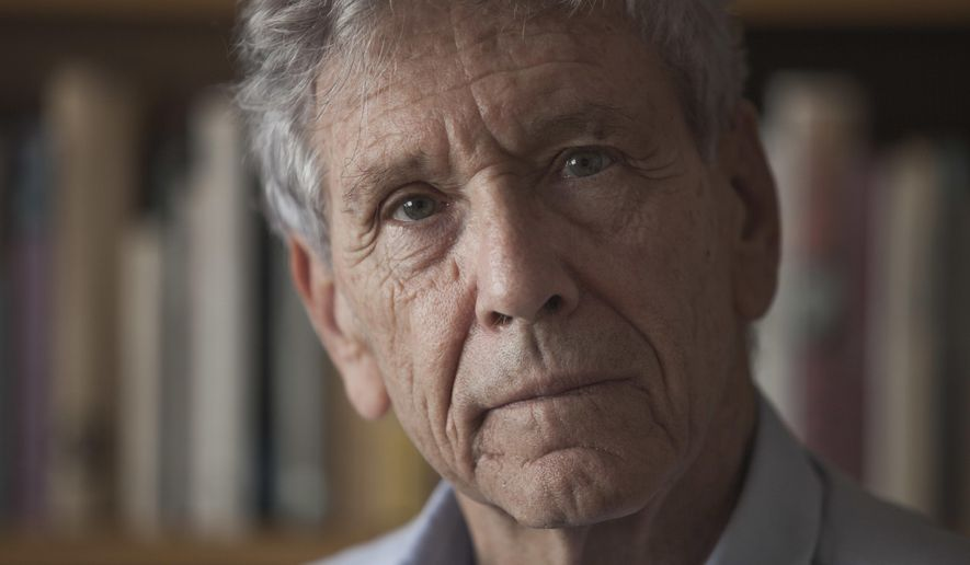 "FILE - A Wednesday, Nov. 4, 2015 file photo of Israeli writer Amos Oz at his house in Tel Aviv. Two of Israel's most renowned authors and an Argentine first-time novelist are among six finalists for the Man Booker International Prize for fiction. David Grossman's ""A Horse Walks Into a Bar,"" Amos Oz's ""Judas"" and Samanta Schweblin's ""Fever Dream"" are on a six-book shortlist announced Thursday, April 20, 2017, for the 50,000 pound ($64,000) prize. (AP Photo/Dan Balilty, File)"