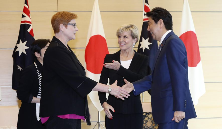 Australian Minister for Foreign Affairs Julie Bishop, center, and  Defense Minister Marise Payne, left, meet with Japanese Prime Minister Shinzo Abe, right, at the prime minister's official residence in Tokyo, Thursday, April 20, 2017. The Australian and Japanese foreign and defense ministers are meeting Thursday to discuss deepening defense cooperation and the growing North Korean nuclear and missile threat. (AP Photo/Eugene Hoshiko, Pool)