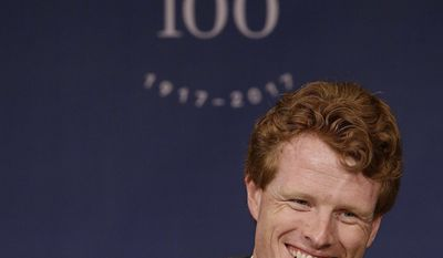 U.S. Rep. Joseph Kennedy III, D-Mass., smiles while he speaks during the John F. Kennedy Centennial Symposium at the Harvard Kennedy School, Thursday, April 20, 2017, in Cambridge, Mass. The symposium honors the 100th anniversary of President Kennedy's birth focusing on the former president's most important priorities and how they remain relevant today. (AP Photo/Stephan Savoia)
