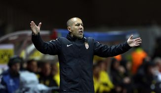 Monaco's head coach Leonardo Jardim gestures during the Champions League quarterfinal second leg soccer match between Monaco and Dortmund at the Louis II stadium in Monaco, Wednesday April 19, 2017. (AP Photo/Claude Paris)