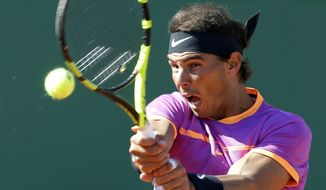 Spain's Rafael Nadal returns the ball to Germany's Alexander Zverev during their third round match of the Monte Carlo Tennis Masters in Monaco, Thursday April 20, 2017. (AP Photo/Claude Paris)