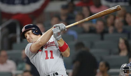 Washington Nationals' Ryan Zimmerman follows through on a two-run home run in the sixth inning of a baseball game against the Atlanta Braves on Thursday, April 20, 2017, in Atlanta. (AP Photo/John Bazemore)