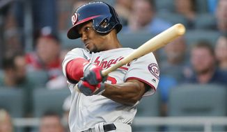 Washington Nationalls' Michael Taylor drives in a run with a sacrifice fly during the second inning of a baseball game against the Atlanta Braves on Thursday, April 20, 2017, in Atlanta. (AP Photo/John Bazemore)