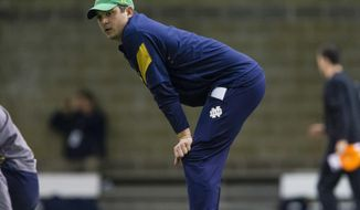 Notre Dame quarterbacks coach Tommy Rees watches during practice at the Loftus Sports Center in South Bend, Ind., Saturday, March 24, 2017. Being in the spotight was not always enjoyable when he was a player.(Michael Caterina/South Bend Tribune via AP)