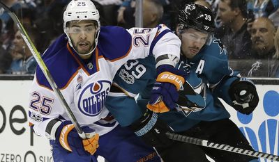 San Jose Sharks' Logan Couture (39) gets tangled with Edmonton Oilers' Darnell Nurse (25) during the first period in Game 4 of a first-round NHL hockey playoff series Tuesday, April 18, 2017, in San Jose, Calif. (AP Photo/Marcio Jose Sanchez)