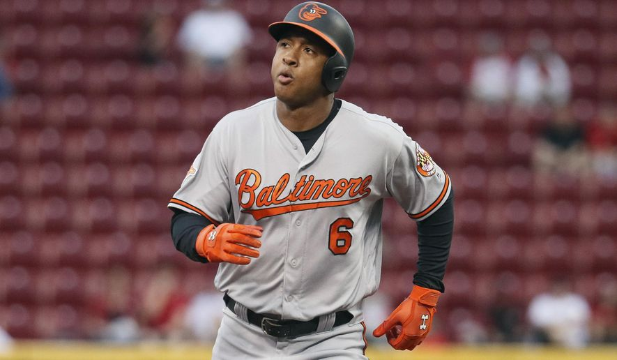 Baltimore Orioles' Jonathan Schoop runs the bases after hitting a solo home run off Cincinnati Reds starting pitcher Scott Feldman in the second inning of a baseball game, Thursday, April 20, 2017, in Cincinnati. (AP Photo/John Minchillo)