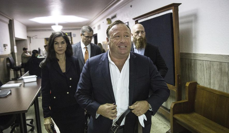 "In this Monday, April 17, 2017, photo, ""Infowars"" host Alex Jones arrives at the Travis County Courthouse in Austin, Texas. (Tamir Kalifa/Austin American-Statesman via AP)"