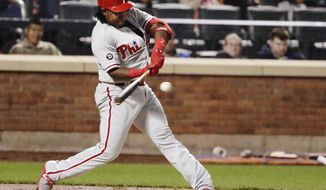 Philadelphia Phillies' Maikel Franco hits an RBI double third inning of a baseball game against the New York Mets on Thursday, April 20, 2017, in New York. (AP Photo/Frank Franklin II)