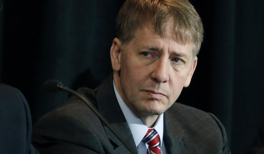 Consumer Financial Protection Bureau Director Richard Cordray listens to a speaker during a a hearing in Denver. State and federal authorities are suing Ocwen Financial Corp., saying the mortgage servicing company botched the handling of millions of mortgage accounts. The Consumer Financial Protection Bureau said Thursday, April 20, 2017, that Ocwen generated errors in borrowers' accounts, failed to credit payments, illegally foreclosed on homeowners, and charged borrowers for add-on products without their consent. Ocwen is one of the nation's largest non-bank mortgage lenders. (AP Photo/Brennan Linsley, File)