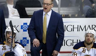 FILE - In this March 5, 2017, file photo, Buffalo Sabres head coach Dan Bylsma expresses himself to an official during the third period of an NHL hockey game against the Pittsburgh Penguins, in Pittsburgh.  The Buffalo Sabres have fired general manager Tim Murray and coach Dan Bylsma after the youthful team missed the playoffs for a sixth consecutive season. Owner Terry Pegula made the announcement Thursday, April 20, 2017. (AP Photo/Gene J. Puskar, File)