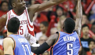 Houston Rockets center Clint Capela, left, blocks the shot of Oklahoma City Thunder guard Victor Oladipo (5) during the second half in Game 2 of an NBA basketball first-round playoff series, Wednesday, April 19, 2017, in Houston. Houston won 115-111. (AP Photo/Eric Christian Smith)