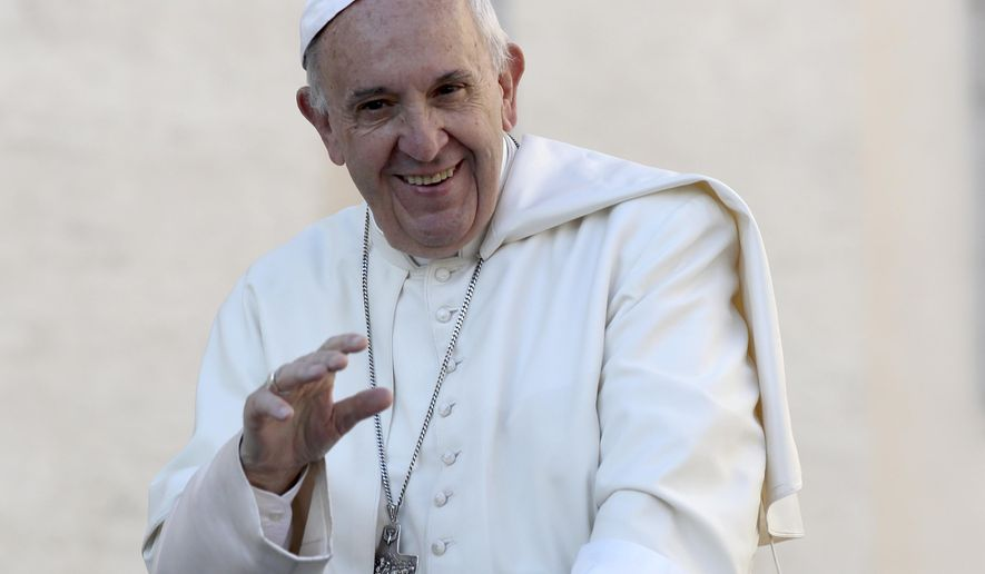 FILE - In this Oct. 19, 2016, file photo, Pope Francis waves to the crowd as he is driven around St. Peter's Square ahead of his weekly general audience at the Vatican. Francis was named to Time's 100 most influential people list on April 20, 2017. (AP Photo/Alessandra Tarantino, File)