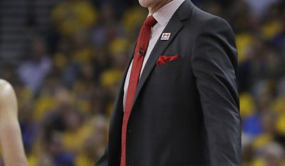 Portland Trail Blazers coach Terry Stotts argues a call during the first half in Game 2 of the team's first-round NBA basketball playoff series against the Golden State Warriors Wednesday, April 19, 2017, in Oakland, Calif. (AP Photo/Marcio Jose Sanchez)