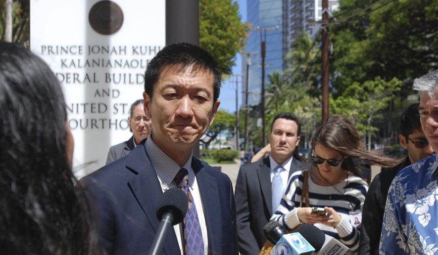 """Hawaii Attorney General Douglas Chin speaks outside federal court in Honolulu in this March 29, 2017, file photo. Hawaii's Democratic lawmakers are criticizing Attorney General Jeff Sessions after he expressed amazement on a radio show that a """"judge sitting on an island in the Pacific"""" could stop the president's travel ban. U.S. Sen. Mazie Hirono on Thursday tried to give Sessions a civics lesson on Twitter, saying Hawaii has been a U.S. state for 58 years. (AP file Photo/Caleb Jones, File)"""