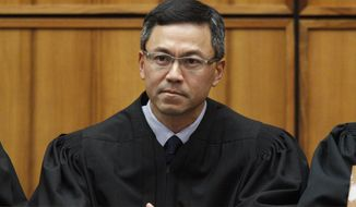 """FILE - This Dec. 2015 file photo shows U.S. District Judge Derrick Watson in Honolulu. Hawaii's Democratic lawmakers on Thursday, April 20, 2017, criticized Attorney General Jeff Sessions after he expressed amazement on a radio show that a """"judge sitting on an island in the Pacific"""" could stop the president's travel ban. Watson last month blocked President Donald Trump's executive order prohibiting new visas for people from six Muslim-majority countries and temporarily halting the U.S. refugee program. The Trump Administration appealed the ruling. (George Lee/The Star-Advertiser via AP, File)"""