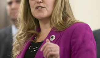 FILE - In this Thursday Jan. 14, 2016, file photo, state Sen. Jennifer Wexton, D-Loudoun, speaks during a news conference by the Senate Democratic caucus at the Capitol in Richmond, Va. Wexton has announced her candidacy for the U.S. House of Representatives, seeking to represent Virginia's 10th Congressional District. (AP Photo/Steve Helber, File)