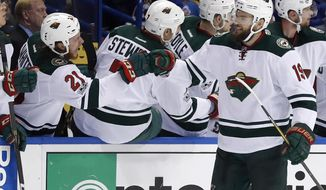 Minnesota Wild's Martin Hanzal, of the Czech Republic, is congratulated by Ryan White (21) after scoring during the second period in Game 4 of an NHL hockey first-round playoff series against the St. Louis Blues on Wednesday, April 19, 2017, in St. Louis. (AP Photo/Jeff Roberson)