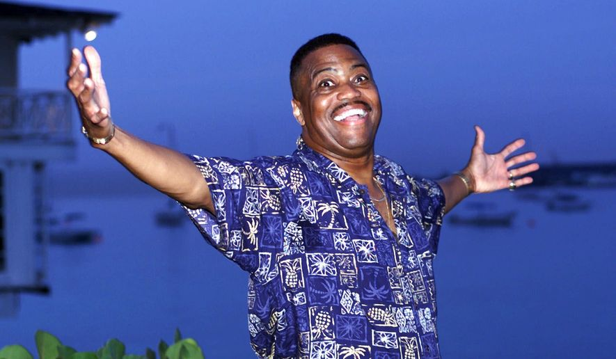 """In this Aug. 18, 1999, file photo, Cuba Gooding Sr., lead vocalist of the legendary r&b/pop group The Main Ingredient, and father of Oscar winning actor Cuba Gooding Jr., gestures during an interview in Bridgetown, Barbados. Gooding Sr., who sang the 1972 hit """"Everybody Plays the Fool,"""" has died. Authorities say the 72-year-old singer was found dead due an unknown cause in a car Thursday, April 20, 2017, in the Woodland Hills section of Los Angeles. (AP Photo/Chris Brandis, File)"""