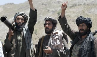 Taliban fighters react to a speech by their senior leader in the Shindand district of Herat province, Afghanistan on May 27, 2016. (Associated Press) **FILE**