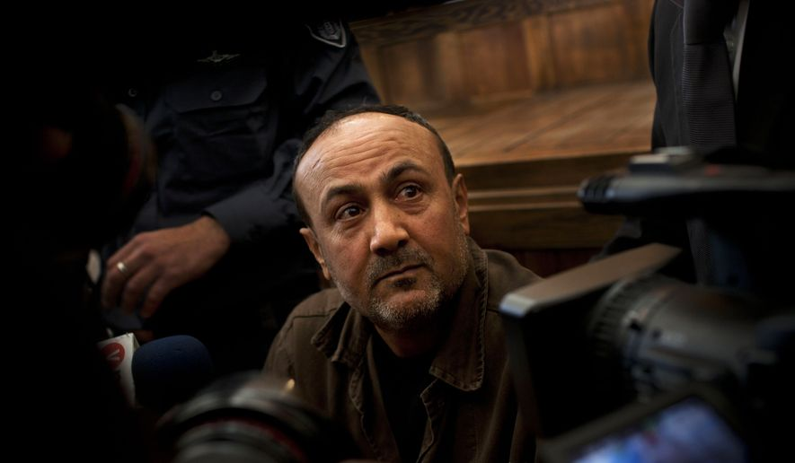 FILE - In this Jan. 25, 2012 file photo, jailed Senior Fatah leader Marwan Barghouti appears in a Jerusalem court. From deep within an Israeli prison, Palestinian uprising leader Marwan Barghouti has once again thrust himself to the forefront of the Israeli-Palestinian conflict. By organizing a mass hunger strike by hundreds of Palestinian prisoners, Barghouti has solidified his standing as a likely successor to President Mahmoud Abbas. (AP Photo/Bernat Armangue, File) **FILE**