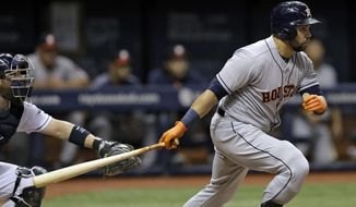 Houston Astros' Carlos Beltran, right, singles off Tampa Bay Rays starting pitcher Alex Cobb during the fourth inning of a baseball game Friday, April 21, 2017, in St. Petersburg, Fla. Rays catcher Derek Norris, left, looks on. (AP Photo/Chris O'Meara)