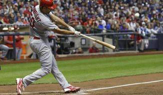 St. Louis Cardinals' Adam Wainwright hits a two-run home run during the third inning of a baseball game against the Milwaukee Brewers Friday, April 21, 2017, in Milwaukee. (AP Photo/Morry Gash)