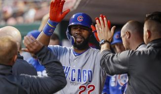 Chicago Cubs' Jason Heyward (22) celebrates in the dugout after hitting a solo home run off Cincinnati Reds starting pitcher Tim Adleman during the fourth inning of a baseball game, Friday, April 21, 2017, in Cincinnati. (AP Photo/John Minchillo)