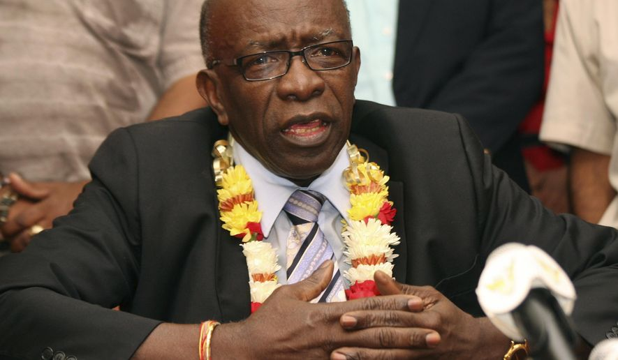 FILE - In this June 2, 2011 file photo, suspended FIFA executive Jack Warner speaks during a news conference held shortly after his arrival at the airport in Port-of-Spain, Trinidad and Tobago. In papers filed earlier this week in federal court in Brooklyn, N.Y., the Confederation of North, Central American and Caribbean Association Football accuses former FIFA officials Jack Warner and Charles Blazer of making a fortune through embezzlement, allegations that mirror those in a sprawling U.S. criminal investigation that has resulted in charges against several top soccer officials. The suit accuses the pair of negotiating bribes and kickbacks in connection with lucrative broadcasting rights for tournaments including CONCACAF's Gold Cup championship. (AP Photo/Shirley Bahadur, File)