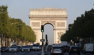 The Arc de Triomphe is pictured on the Champs Elysees boulevard in Paris, early Friday, April 21, 2017. (AP Photo/Michel Euler) ** FILE **