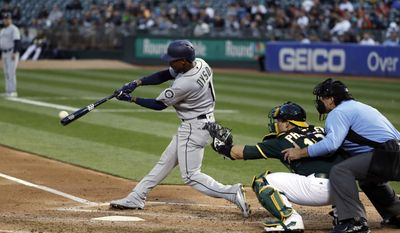 Seattle Mariners' Jarrod Dyson (1) drives in a run with a single against the Oakland Athletics during the second inning of a baseball game Thursday, April 20, 2017, in Oakland, Calif. (AP Photo/Marcio Jose Sanchez)