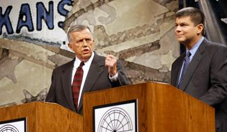 FILE - In this Oct. 13, 2002, file photo taken in Conway, Ark., former Republican congressman Jay Dickey, left, debates the man who had replaced him two years earlier, Democrat Mike Ross. A funeral home confirmed Friday, April 21, 2017 that Dickey, who served four terms from southern Arkansas, had died but did not provide details, including the date. He was 77. (AP Photo/Spencer Tirey, File)