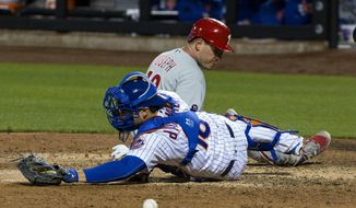 Philadelphia Phillies' Tommy Joseph scores in the 10th inning as the ball gets away from New York Mets catcher Travis d'Arnaud during a baseball game Tuesday, April 18, 2017, in New York. The Phillies won 6-2. (AP Photo/Craig Ruttle)